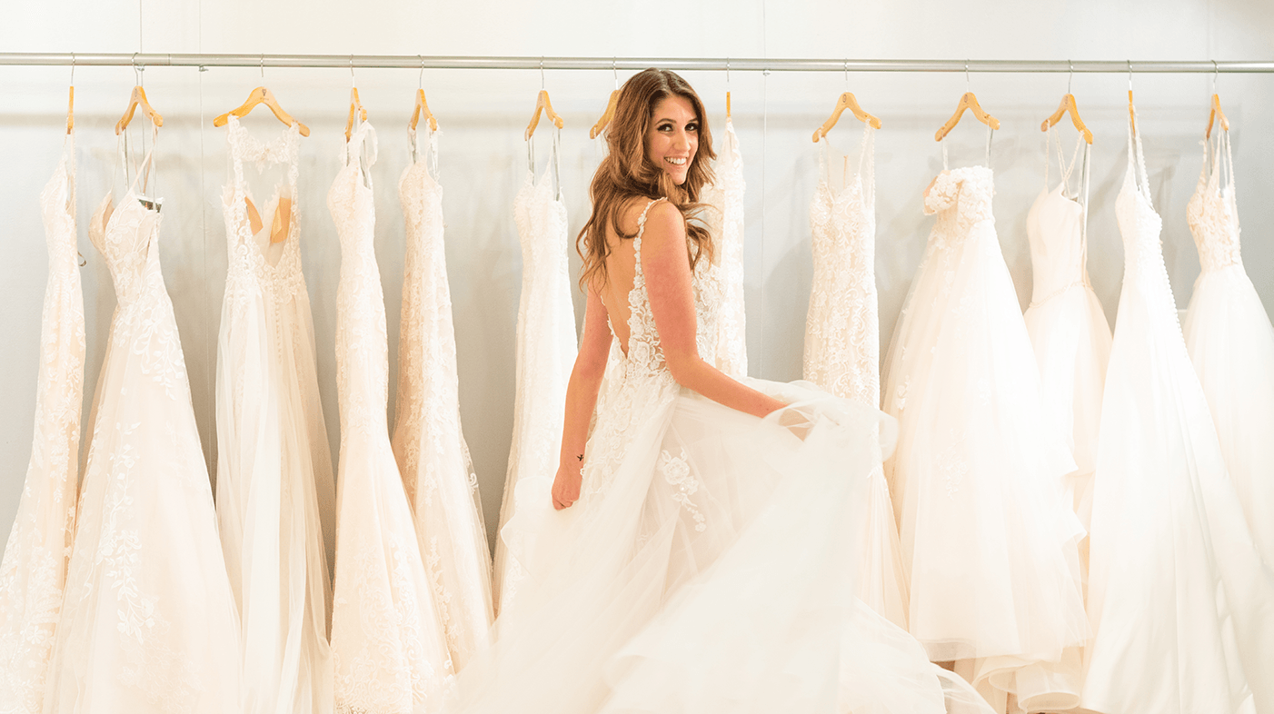 VOW | New World of Bridal - Model in Wedding Dress by Rack